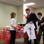 Jade Yancy Accepting award from Jeff Merrell